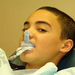 Young boy receiving fluoride treatment