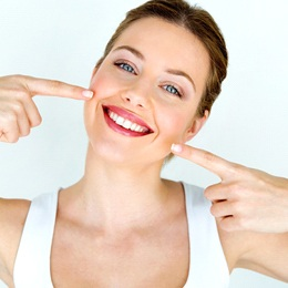 attractive woman pointing at new smile
