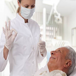 Senior man smiling at dentist