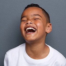 Little boy with beauitful smile laughing