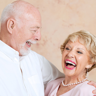 Happy senior couple smiling together