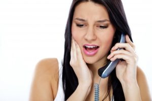 woman with toothache calling an emergency dentist in Scarborough, Toronto