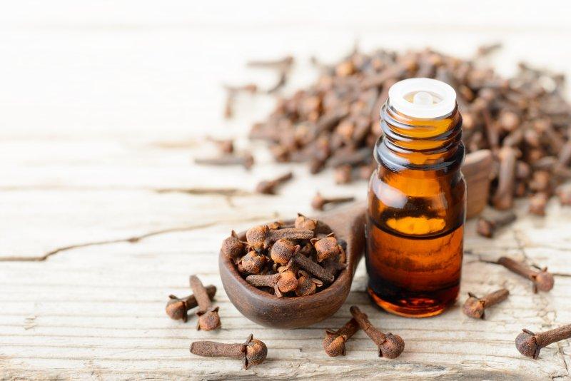 clove oil on wooden table